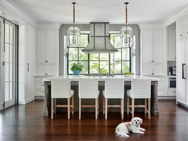 Kitchen hood in front of window A custom varnished steel hood was placed right in front of the casement black steel windows. The beams framing the windows are custom lime-washed Timber #kitchen #Kitchenhood #window