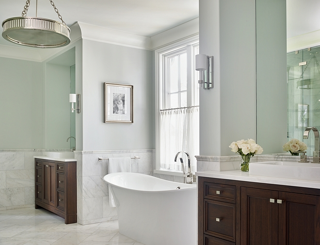 Bathroom paint color Benjamin Moore Horizon Wall paint color is Benjamin Moore Horizon A freestanding tub is tucked into a nook located between the vanities #BenjaminMooreHorizon