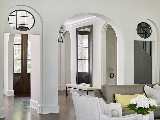 Custom black steel interior round windows add an impressive detail to the arched doorways of this home Custom black steel interior round windows add an impressive detail to the arched doorways of this home Custom black steel interior round windows add an impressive detail to the arched doorways of this home #blacksteelwindows #interiorwindows #roundbwindows #interiorblackwindows #archeddoorways