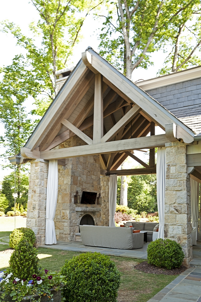 Stone Loggia This stunning loggia features impressive ceilings with limed Timber trusses and slate roof #loggia #stoneloggia #stonefireplace #timber #limedTimber #trusses #slateroof