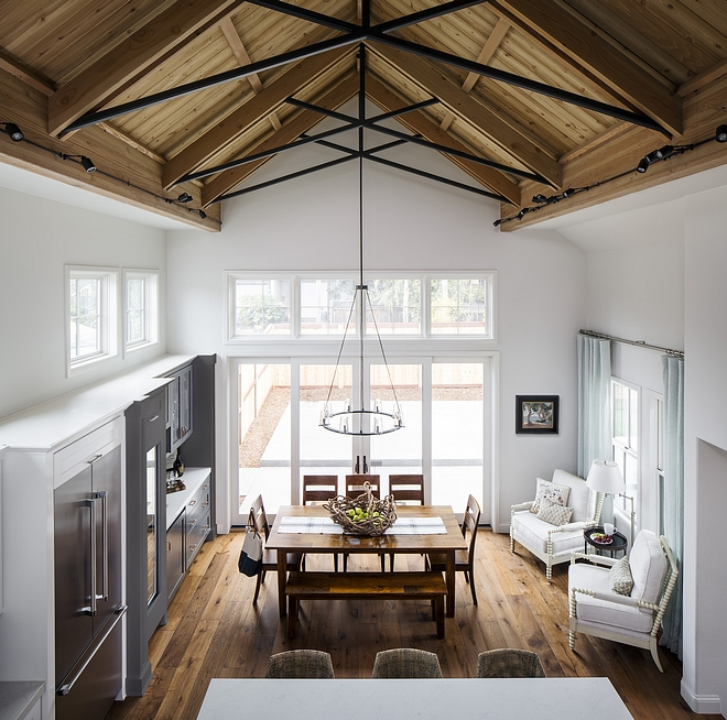 Sherwin Williams Ethereal White kitchen and dining area with Fir cathedral ceiling and Hickory hardwood flooring #SherwinWilliamsEtherealWhite #Firceiling #ceiling #cathedralceiling #Hickoryhardwoodflooring #hardwoodflooring #Hickory