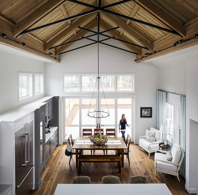 An impressive cathedral ceiling makes the kitchen and dining area feel extra spacious. Notice how the patio doors and transoms bring natural light into this room