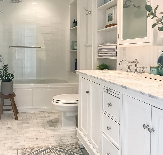 Bathroom with store bought vanity with carrara marble countertop and honed carrara marble subway tile used as flooring #bathroom #storeboughtvanity #vanity #carraramarble #marblesubwaytile #floortile #bathrooms