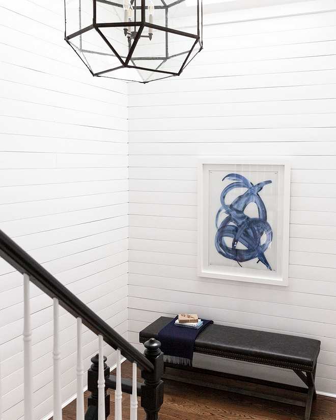Staircase renovation The newly-painted staircase features white shiplap and a new lighting fixture Staircase reno #staircasereno #staircase #renovation