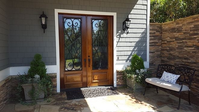 Front door is Tucker, mahogany w/iron accents