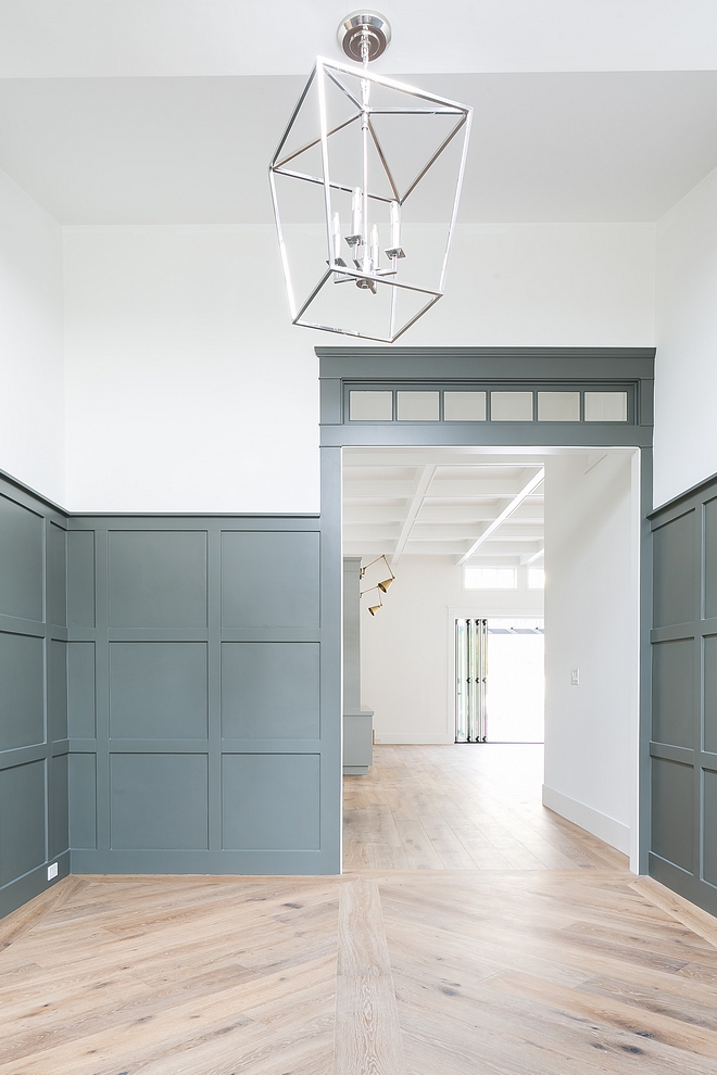 Grey grid board and batten paneling The front door opens to an impressive foyer with grey grid board and batten paneling Paint color is Sherwin Williams SW7068 Grizzle Gray #greygridboardandbatten #greyboardandbatten #greypaneling #SherwinWilliamsSW7068GrizzleGray