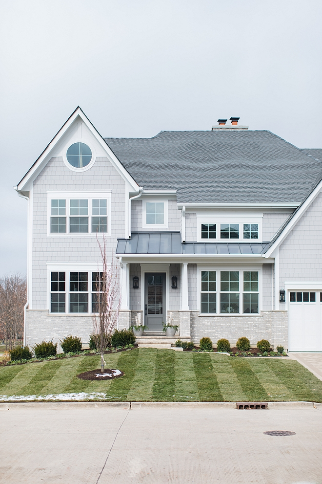Grey shingle home exterior Siding is James Hardie Shakes in Pearl Gray.Trim: Hardie Arctic White #Siding #JamesHardie #JamesHardieShakes #JamesHardiePearlGray #HardiePearlGray