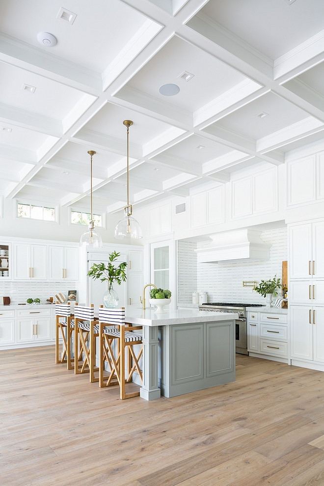 Coastal Farmhouse White Kitchen with light grey island and boxed beamed coffered ceiling #CoastalFarmhouse #WhiteKitchen #lightgreyisland #boxedbeamedceiling #cofferedceiling