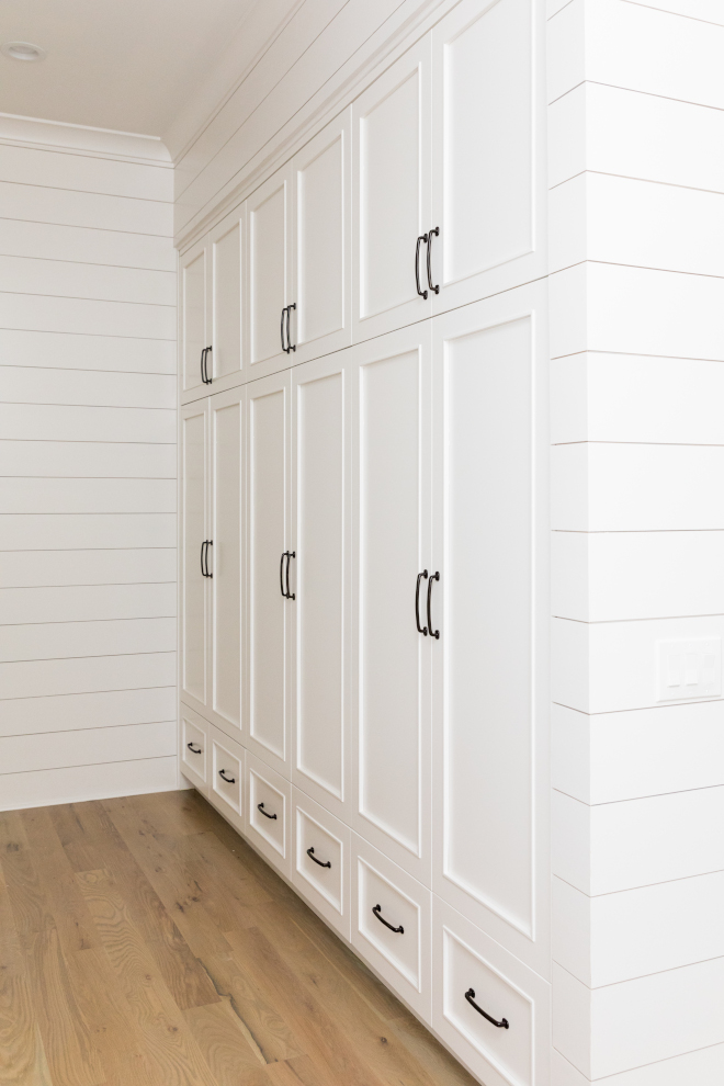 "Mudroom cabinet This mudroom with shiplap is dreamy Walls are clad in shiplap and cabinets feature inset doors and drawers Flooring is 5"" White Oak hardwood #mudroom #cabinet #mudroomcabinet #insetcabinet #mudroomdrawers #mudroomcabinetdoor #mudrooms #hardwoodflooring #shiplap"