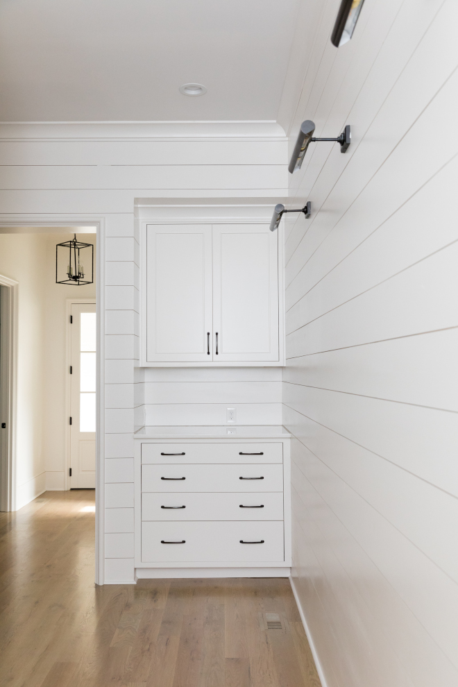 "Mudroom Mudroom Drop Zone with shiplap A ""drop zone"" featuring a custom cabinet with drawers and upper cabinets complete this mudroom Paint color is Sherwin Williams Snowbound #Mudroom #DropZone #shiplap"