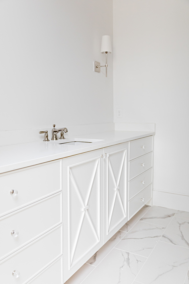 White vanity Bathroom cabinetry is inset flat paneled slabs with x detail Paint color is Sherwin Williams SW 7004