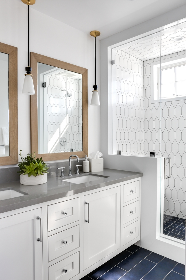 Bathroom with grey quartz countertop, white cabinets and unique flooring and wall tile #batthroom #Bathrooms #greyquartz #greycountertop #whitecabinets #uniqueflooring #uniquetile