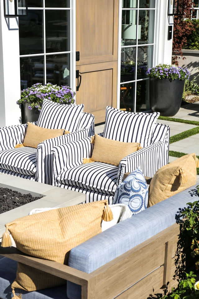 Comfortable outdoor furniture is more inviting and allows you to stay outside for a longer period of time Gorgeous striped upholstered outdoor chairs Comfortable outdoor furniture #outdoorfurniture