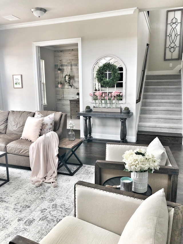 Grey Paint Color The walls and ceilings throughout the home are painted PPG Whiskers in flat. The trim throughout is PPG Gypsum in semi-gloss. #graypaintcolor #grayinteriors #gray #paintcolor