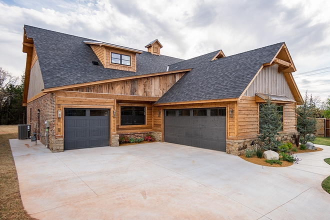Sherwin Williams Iron Ore This home features very interesting architectural details and it certainly feels like a rustic mountain home A three-car garage is located on the left wing of the house Garage doors are painted in Sherwin Williams Iron Ore Sherwin Williams Iron Ore #SherwinWilliamsIronOre