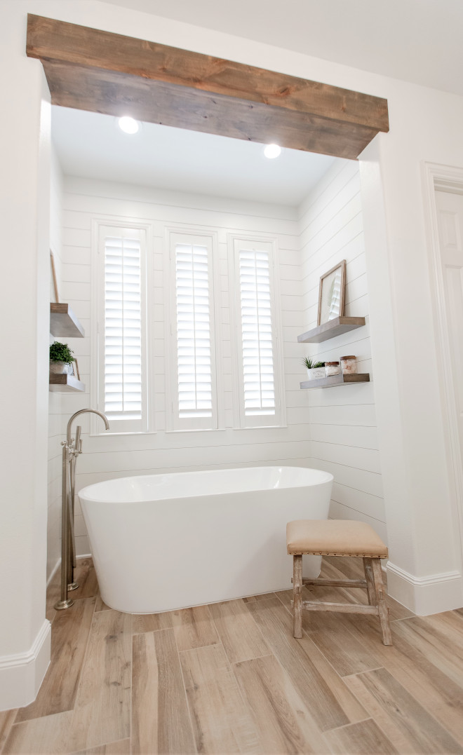 Bathroom beam Bathroom ceiling and shiplap This pictures gives an up close look of the beautiful spa tub and how the shiplap provides the right amount of texture and detail around it #Bathroom #beam #shiplap