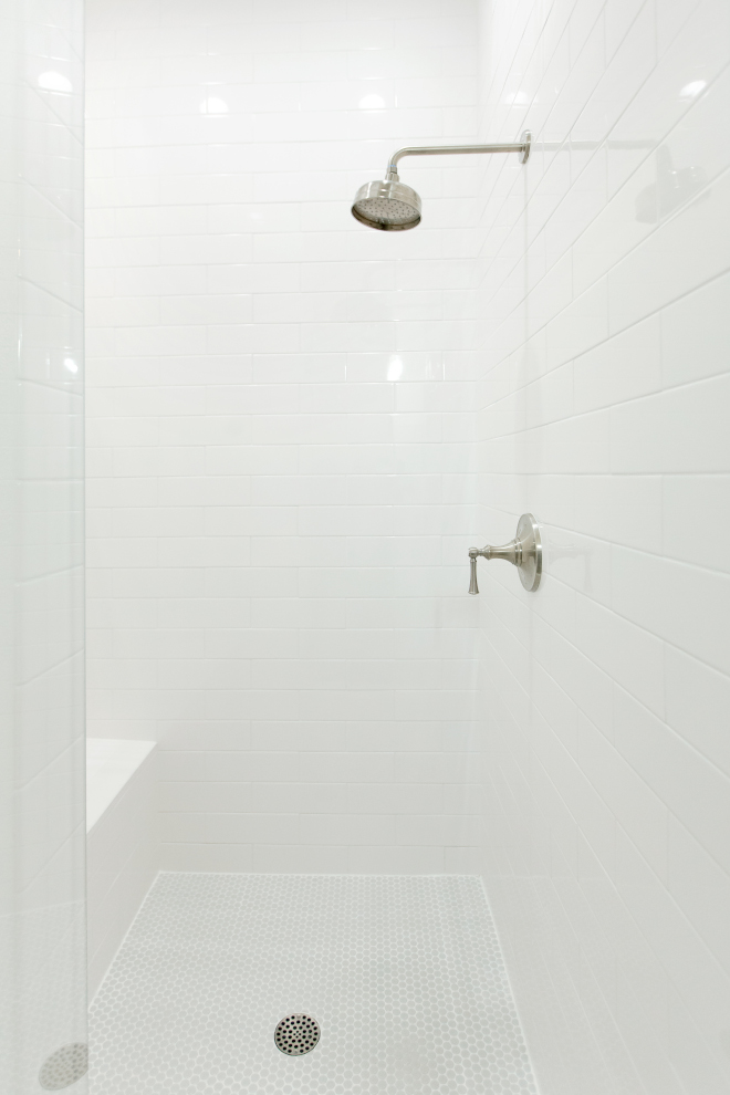 Simple Shower Tile Ideas The shower is now much larger and wrapped in beautiful white tile. I chose the light gray penny tile to add a touch of color and the penny tiles feel so soothing on your feet #showertile #largesubwaytile #tile #shower