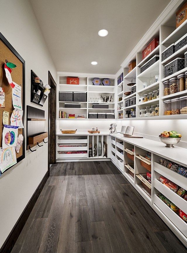 Pantry The large pantry allows the family to stay stocked with everyone's favorite after school snacks and additional bulk pantry items Pantry Cabinet paint color Benjamin Moore Chantilly Lace in Satin Finish #pantry #largepantry #BenjaminMooreChantillyLace
