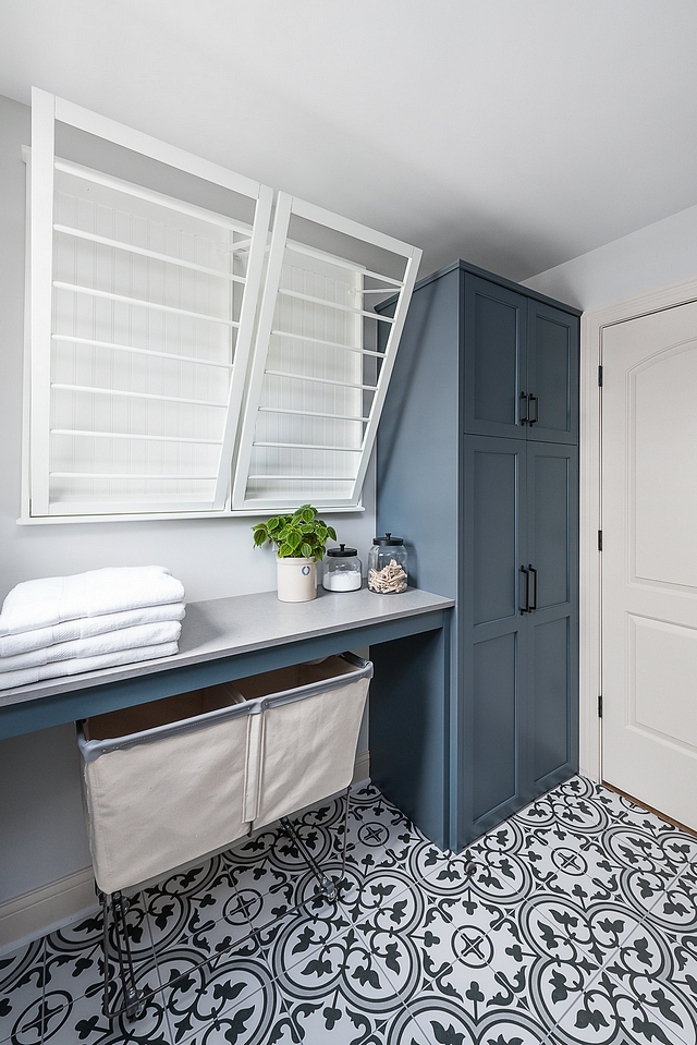 Laundry room renovation brand new cabinetry was added, along with a true designated area for folding laundry and wall-mounted drying racks Laundry Room Laundry Room Renovation #LaundryRoom #renovation #dryinracks #foldingarea