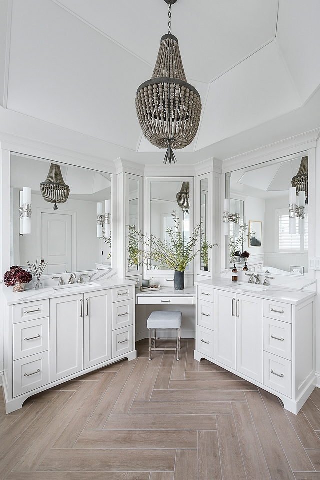 Bathroom vanity Beautifully designed double vanity that wraps the corner with mirrors and provides and extra spot with seating for putting on makeup #Bathroom #vanity #doublevanity