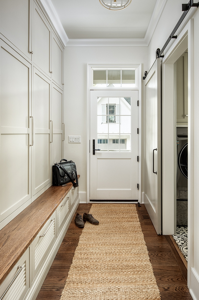 Mudroom cabinet paint color is Duron 8683 Tinderbox and the walls are Benjamin Moore OC-45 Swiss Coffee Mudroom paint color #Mudroom #mudroom #mudroomcabinet #mudroompaintcolor #DuronTinderbox #BenjaminMooreOC45SwissCoffee #Mudrooms #paintcolors