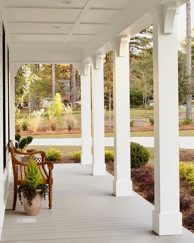 Front Porch Architectural Details The porch flooring is AZEK, Harvest Collection in Slate Gray. Notice the classic square porch columns and the coffered ceiling #frontporch #porch #architecturaldetails #porchflooring #azek #porchcolumns #squarecolumns #cofferedeciling