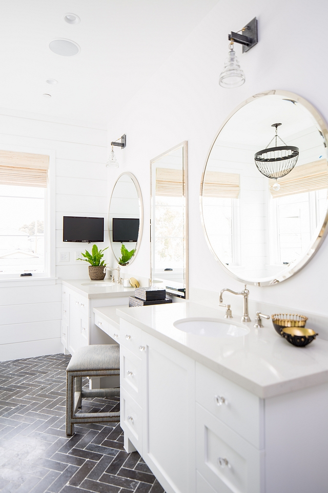 Bathroom vanity with double sinks and make-up vanity in the center The cabinet paint color is Dunn Edwards White and countertop New Carrara Quartz #bathroom #vanity #cabinet #countertop