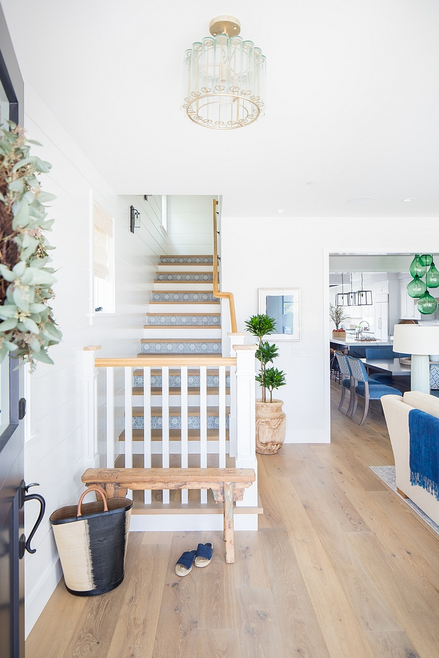 Coastal Bohemian Interior Design Ideas Notice that the staircase is accentuated with blue and white patterned tiles Coastal Bohemian Interiors Coastal Bohemian Home Decor Home with Coastal Bohemian Interiors #Coastal #Bohemian #Interiors #interiordesign #homedecor #CoastalBohemian