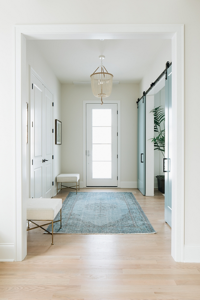Benjamin Moore Classic Gray foyer with white trim and aqua blue barn doors leading to home office Benjamin Moore Classic Gray Benjamin Moore Classic Gray Benjamin Moore Classic Gray Benjamin Moore Classic Gray #BenjaminMooreClassicGray #foyer #bluebarndoor #aquabarndoor #barndoor