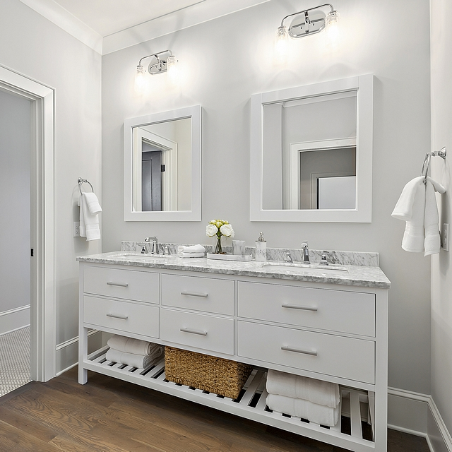Paint color  Benjamin Moore Moonshine bathroom Carrying the hardwoods into the bathroom is a great look, especially given the white furniture vanity #bathroom #Paintcolor #BenjaminMooreMoonshine