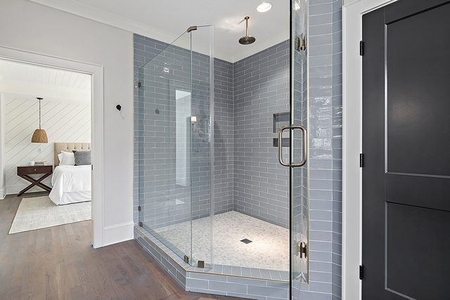 Blue grey subway tile shower We went with this bold blue grey tile for the master shower Adding the brass banding and brass hardware really compliments the look. To not overwhelm the eyes, we went with white/grey tile on the floor #bluegreytile #subwaytile #showertile #shower #bathroom