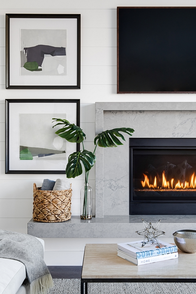 The fireplace features a grey marble surround and hearth bench #fireplace #fireplacehearth #fireplacesurround