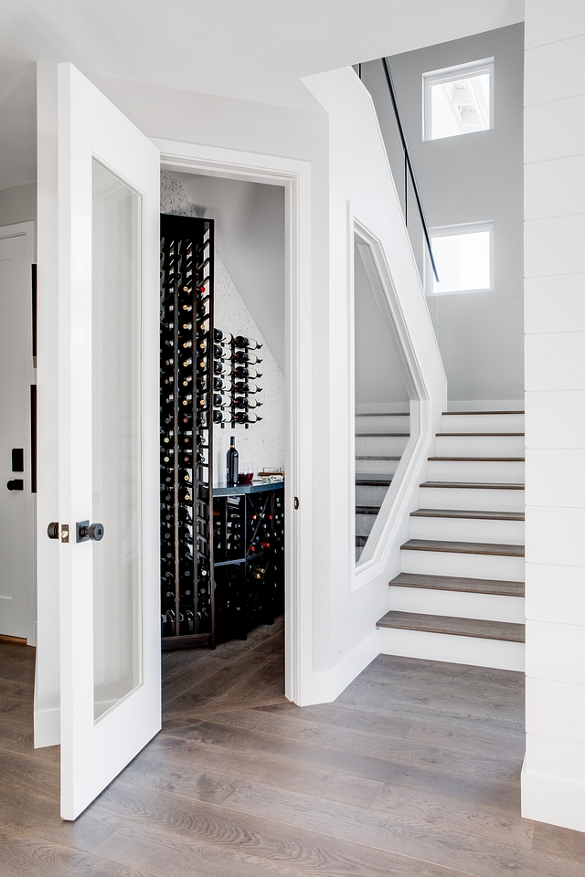 Wine cellar The wine cellar is located under the stairs and it features a glass door wine cellar wine cellar wine cellar #winecellar #understairswinecellar #wine