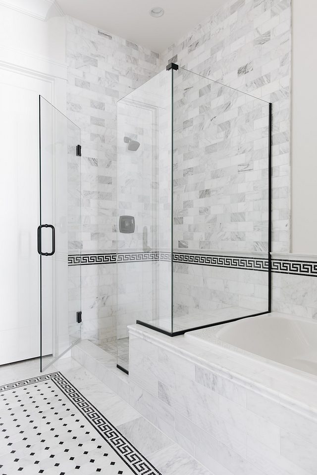 Greek key border tile Bathroom Greek key border tile The glass shower features marble subway wall and floor tiles and it's accented with black and white Greek key border tiles #Bathroom #Bathroomtile #Greekkeytile #bordertile
