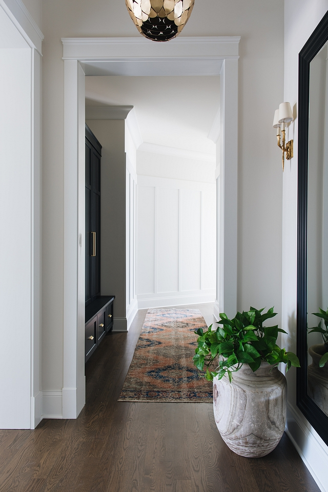 Mudroom Hallway Mudroom The mudroom of this house is actually a hallway that connects the bedrooms, the garage, and the laundry room. There is not a closed off area where mess can accumulate. We needed to make sure the mudroom had more than just hooks and a bench. That would get very messy to walk past every day. We had custom built-ins made that hide all the mess The board and batten on the walls gives an architectural feel but also helps to protect the walls in a high traffic area Mudroom Hallway Mudroom #Mudroom #HallwayMudroom