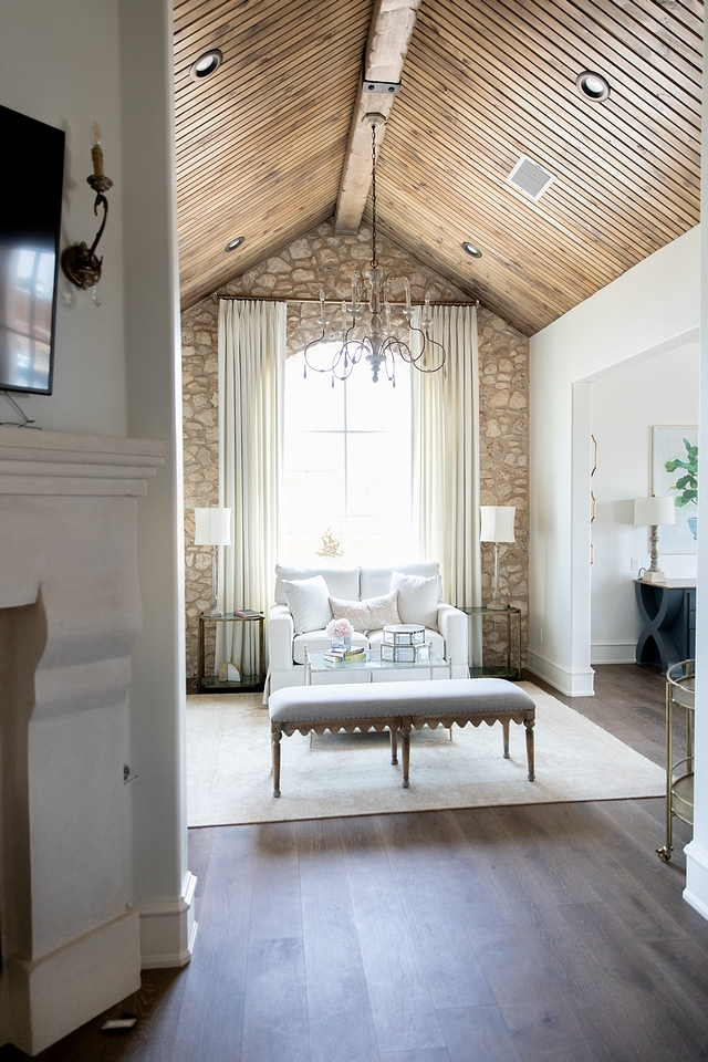 Bedroom sitting room with cathedral ceiling clad in tongue and groove paneling and stone accent wall French master bedroom sitting room with cathedral ceiling clad in tongue and groove paneling #Bedroom #sittingroom #Frenchbedroom #Frenchsittingroom #cathedralceiling #tongueandgroove ##tongueandgrooveceiling