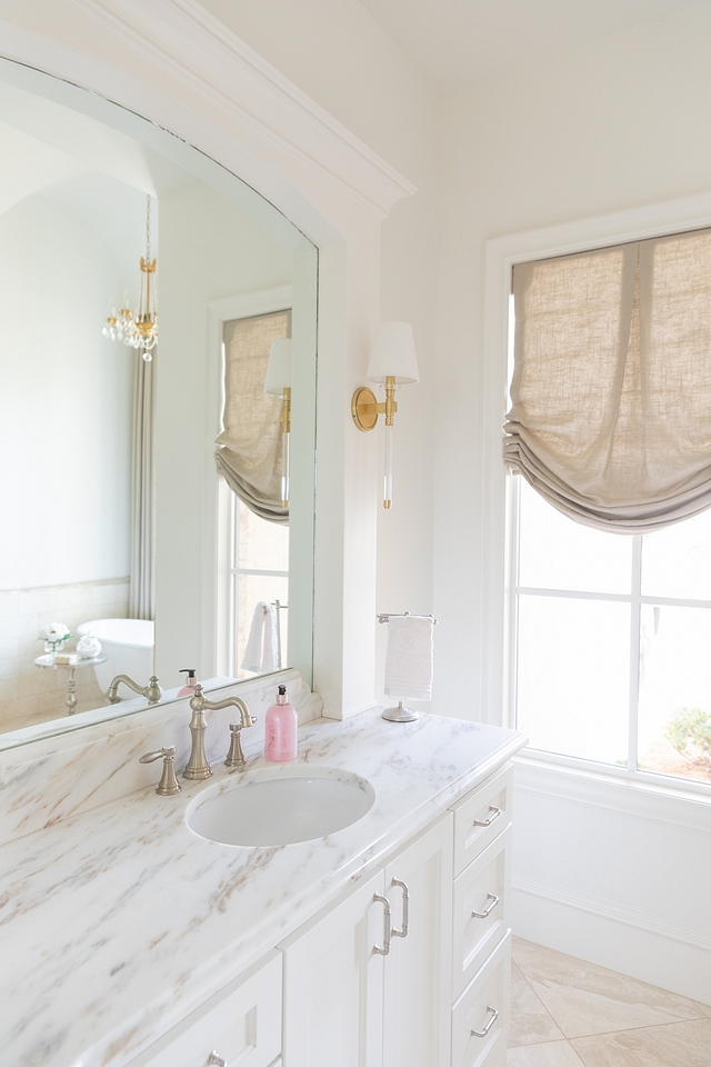 Bathroom white paint color is Sherwin Williams Alabaster Bathroom Countertop is Honed Imperial Danby Marble #bathroom #paintcolor #countertop