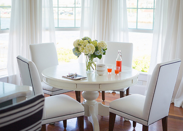 navy blue chair with ottoman balcony height patio chairs beach house airy coastal interiors - home bunch interior design ideas