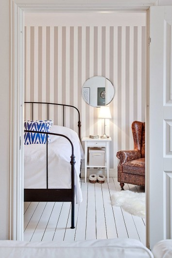 Wallpaper Designs White Bedroom with Neutral Stripe Striped Wallpaper and Black Framed Bed