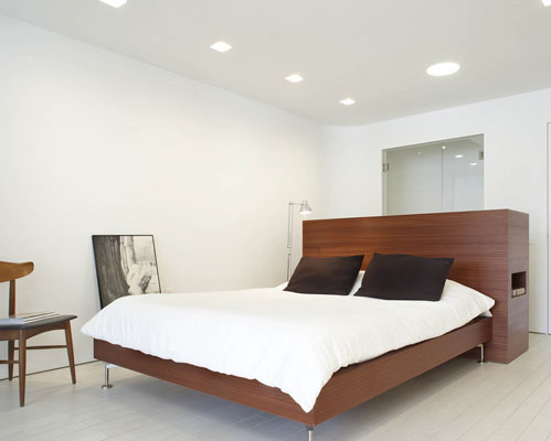 Modern-clasic-bedroom-in-white-and-brown-shades-with-comfortable-bed
