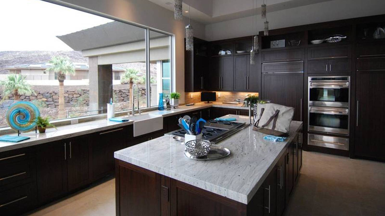 Contemporary kitchen with dark wood cabinets and white