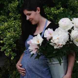 Gardening Maternity Photo with Peonies | Home for the Harvest