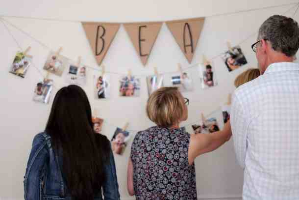 A photo string is the perfect easy way to make your own photo wall! It's perfect for party decor or even to brighten up your everyday space! Best of all, it won't leave any holes in your wall. #photostring #photowall #easypartydecor #DIYparty #DIYdecor