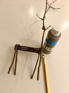 SO cute! This twig reindeer Christmas craft is perfect for your holiday craft night! Use these DIY twig reindeer to decorate your mantle this holiday season! #twigreindeer #stickreindeer #DIYreindeer #ChristmasReindeer
