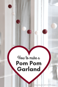 Love this Valentine's Day felted pom pom garland! It's easy to DIY yourself at home. This Valentine's garland makes a lovely piece of Valentine's decor and will last for many years! #ValentinesGarland #ValentinesDecor #ValentinesDayDecor #ValentinesDIY