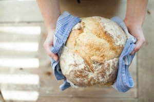 Person holding fresh baked bread