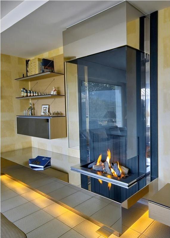20 Spectacular Fireplaces For a Trendy Home  Modern Fireplace designs  Home Interiors Blog