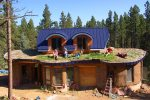 This is a cobb and straw-bale mountain cottage with an earth sheltered (green) roof...