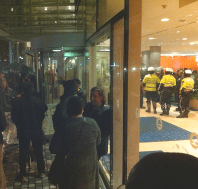 Photo of police inside the hotel during the protest against the National Conference on Ending Homelesness