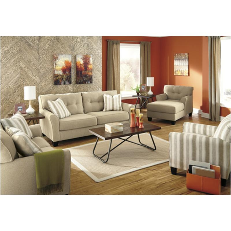 living room with sofa and two accent chairs framed art 5190238 ashley furniture laryn khaki